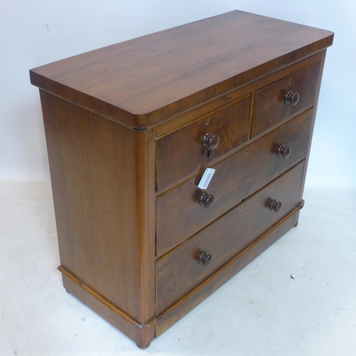 778 - A Victorian walnut chest of drawers, raised on bun feet, H.85 W.101 D.45cm...