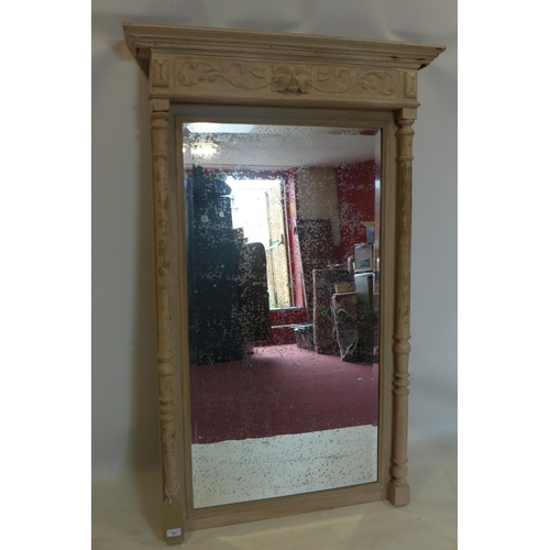 811 - An early 20th century painted oak mirror, with green man carving and ghosted bevelled plate, 141 x 9...