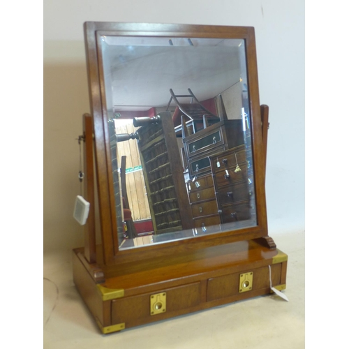 839 - A Campaign style vanity mirror by Kennedy, with 2 drawers and bevelled glass plate, H.70 W.52 D.26cm...