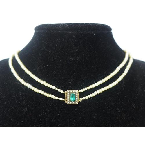 861 - An antique graduated, double-row seed pearl necklace composed of cream coloured pearls to a yellow g...