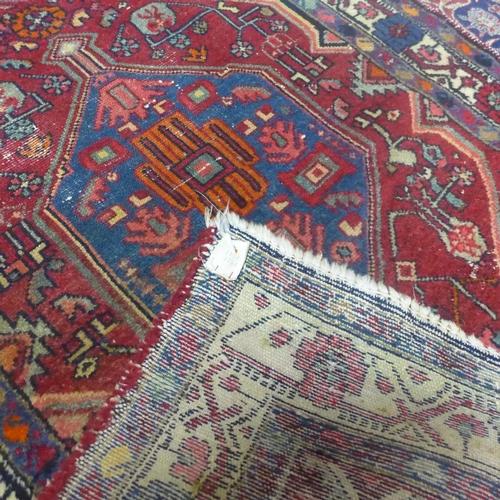 872 - A 20th century Hamadan rug, 188 x 95cm...