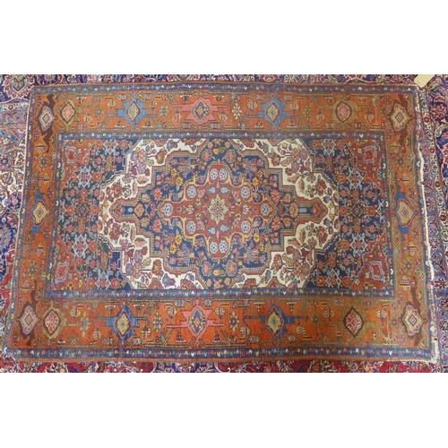 875 - An antique Heriz rug, 192 x 133cm...