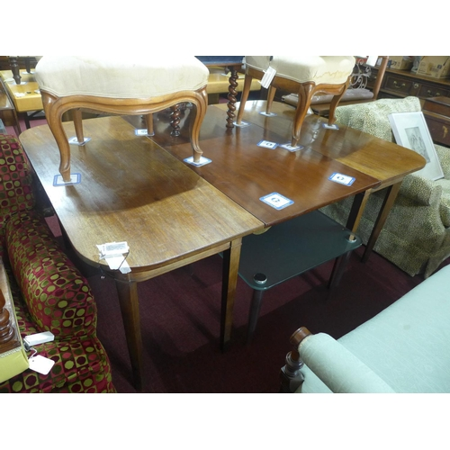 517 - A 19th century mahogany dining table, with extra leaf, raised on tapered legs, H.71 W.170 D.127cm...