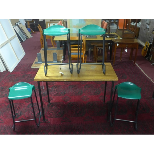 501 - A set of four green 'Metalliform' stools with teak top table, H.85 W.120 D.60cm...