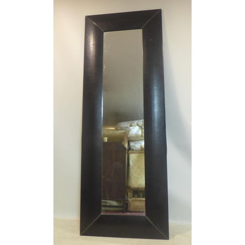 502 - A large leather clad mirror, 222 x 80cm...