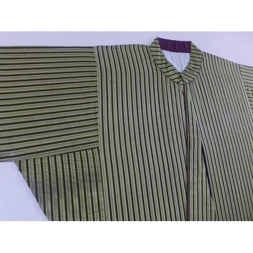 505 - A green and black silk robe/kimono mounted to canvas...