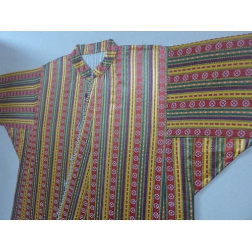 506 - A multi coloured silk robe/kimono mounted to canvas...