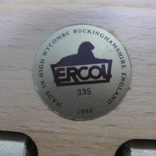 510 - A near pair of Ercol armchairs...