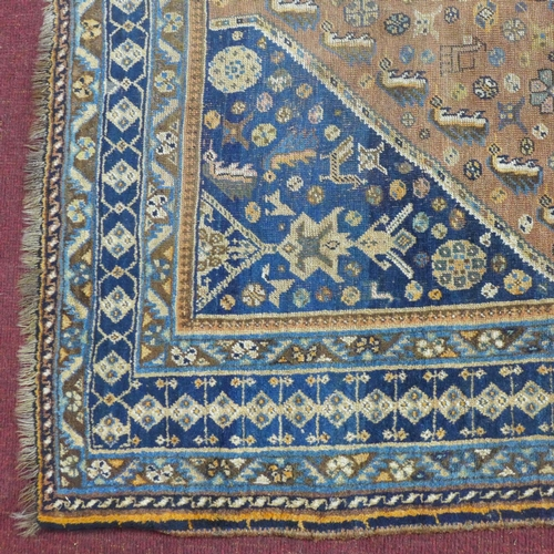 515 - An antique Qashqai carpet with geometric medallion surrounded by geometric motifs, on a brown ground...