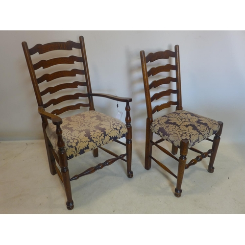 524 - A set of 8 20th century oak ladder back dining chairs to include two carvers...