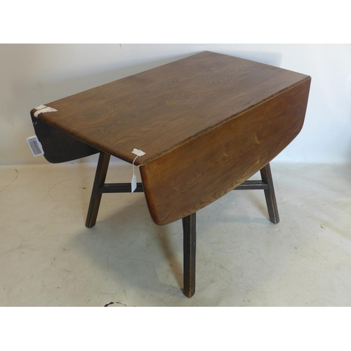 527 - A 20th century Ercol drop leaf dining table...