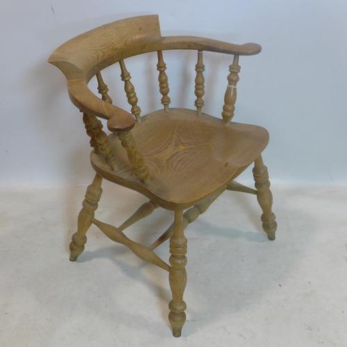 543 - A 20th century pine captains desk chair...