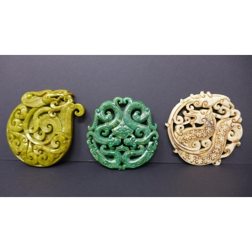 625 - Three, Chinese hand-carved hard-stone amulets/pendants in shades of dark green 6.5 x 6.5cm, white 7 ...