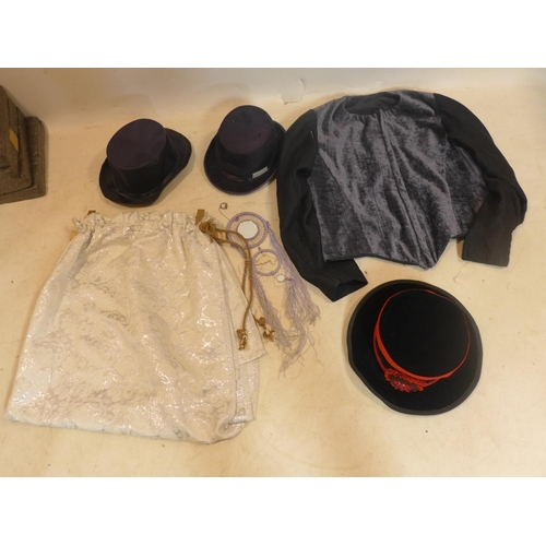 21 - A collection of dress-up items to include 3 hats, a jacket and a skirt...