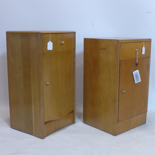77 - A near pair of 20th century light oak side cabinets...
