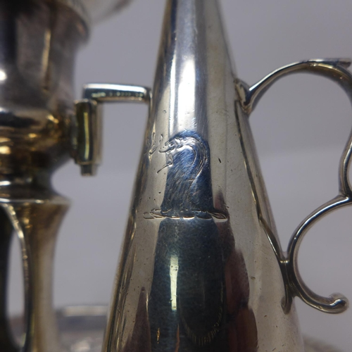 94 - A pair of George III silver chambersticks with snuffers, by Henry Hodbell, London 1772, having scrol...