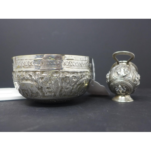 138 - An Indian white metal bowl, repousse embossed with a continuous procession of animals within scrolli...