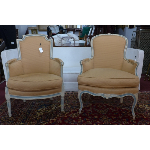 208 - Two late 19th/early 20th century French cream and blue painted armchairs...