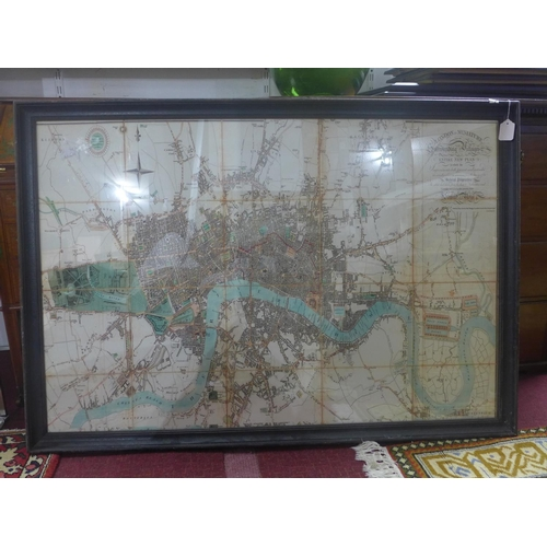 250 - A large reproduction map of London, framed and glazed, 82 x 122cm...
