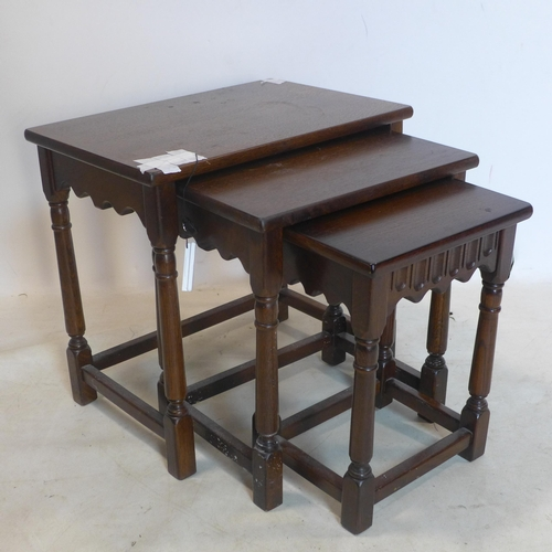 251 - An early 20th century oak nest of tables...