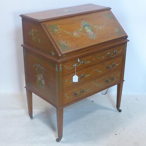 257 - A 19th century satinwood bureau, hand painted with portrait and flowers, raised on tapered legs and ...