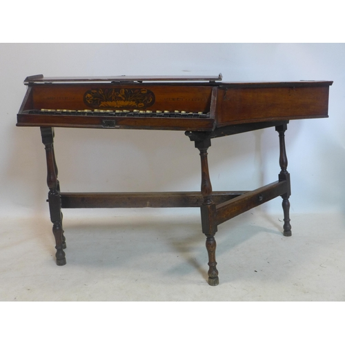 261 - An antique mahogany cased spinet, with marquetry inlay, raised on oak stand, needs restoring...