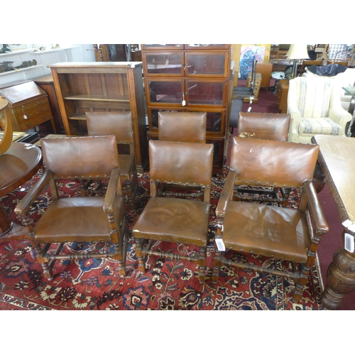 293 - A set of six 19th century oak dining chairs, with studded leather upholstery, to include 2 carvers...