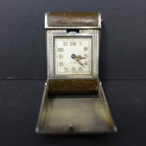 399 - A silver and leather travel clock, the square dial with Arabic numerals and marked Facille, marked, ...