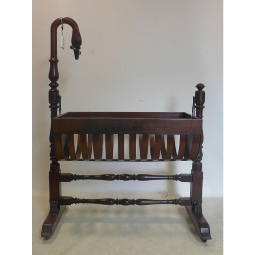 260 - A Victorian mahogany rocking crib on stand, with swan neck finial, H.103 W.104 D.59cm...
