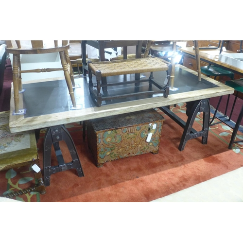 542 - An Industrial style table, raised on metal supports, W.200 D.91cm...