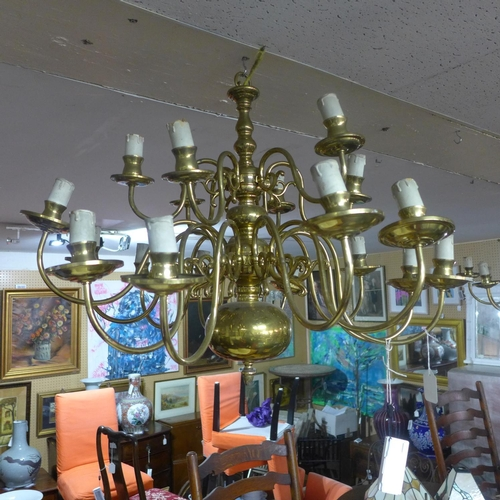 599 - A pair of 20th century 18 branch brass chandeliers...
