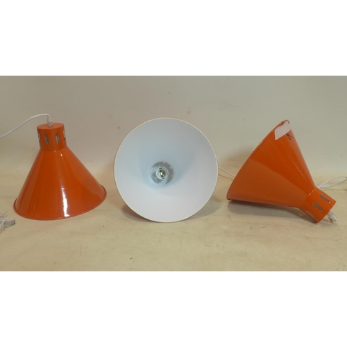 660 - A set of 3 brand-new orange enamelled metal ceiling lights (white enamel interiors) complete with fi...