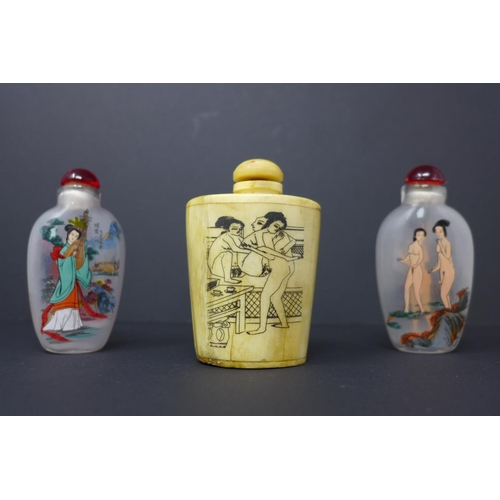 867 - Three Chinese snuff bottles to include a buffalo bone hand-carved erotic example with 2 Peking glass...