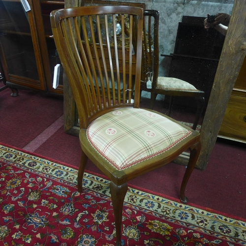 504 - An Edwardian inlaid mahogany chair...