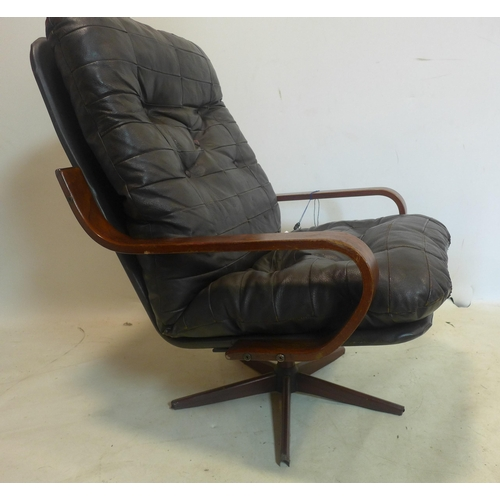 505 - A 20th century Danish swivel armchair...