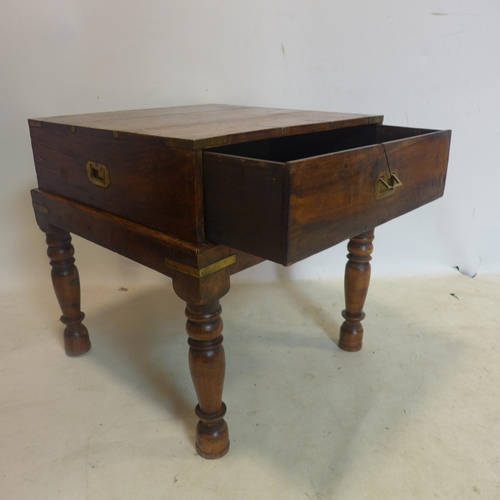506 - A 20th century campaign style brass bound teak chest on stand, H.60 W.60 D.60cm...