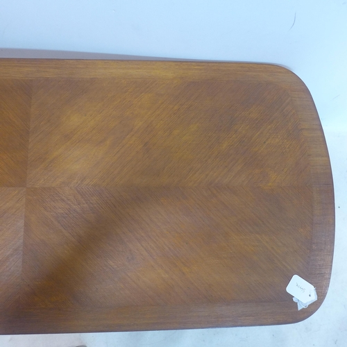 507 - A 20th century teak coffee table, H.41 W.120 D.53cm...