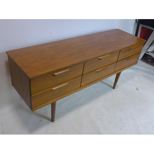 508 - A 20th century teak sideboard with 6 drawers, raised on tapered legs, H.70 W.154 D.42cm...