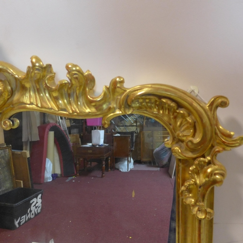 510 - A 19th century Rococo gilt wood over mantle mirror, 140 x 115cm...