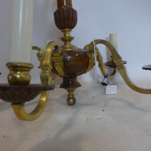 511 - A quality vintage walnut and brass chandelier...