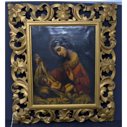 514 - A late 19th / early 20th century oil on canvas of Mary and infant Jesus, unsigned, with hole and sma...