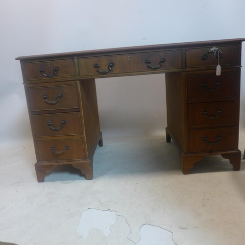556 - A Georgian style mahogany pedestal desk, H.74 W.121 D.65cm...