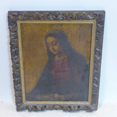 698 - A 19th century oil on canvas laid down on panel of the Virgin Mary, with gilt background, in a gilt ...