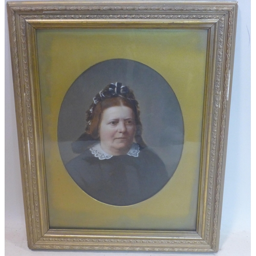 699 - A Victorian portrait of an elderly lady, feigned to oval, oil on paper laid down, in giltwood frame,...