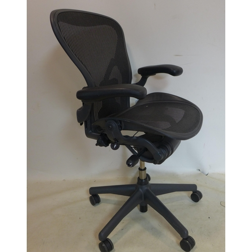 710 - A Herman miller Aeron swivel desk chair...