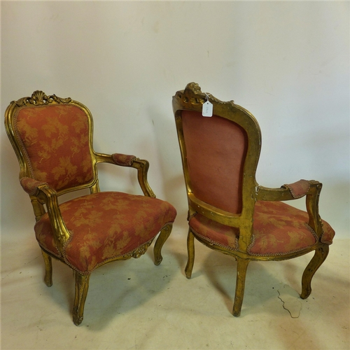 728 - A pair of Louis XV style gilt wood armchairs...