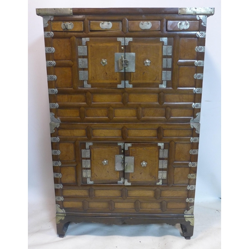 738 - A late 19th/early 20th century Korean marriage cabinet, in 2 sections with white metal mounts and fi...