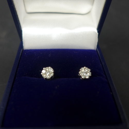 847 - A pair of 9ct yellow gold and 18ct white gold diamond stud earrings, boxed...