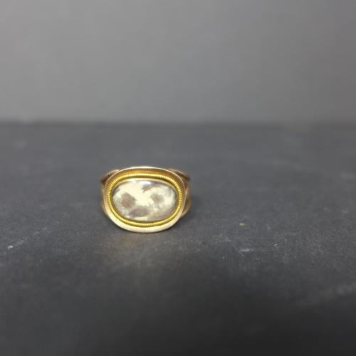 848 - A Georgian yellow metal mourning ring...