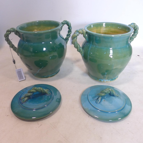 47 - A pair of Persian cyan glazed pots and covers, with rope twist design handles, H.33cm (2)...
